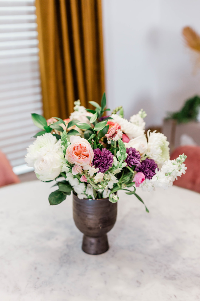 woman working from home at desk, UrbanStems, Flower Delivery, Fresh Florals, Black Girl Arranging Flowers, Black woman decorating in her home, Flower arranging
