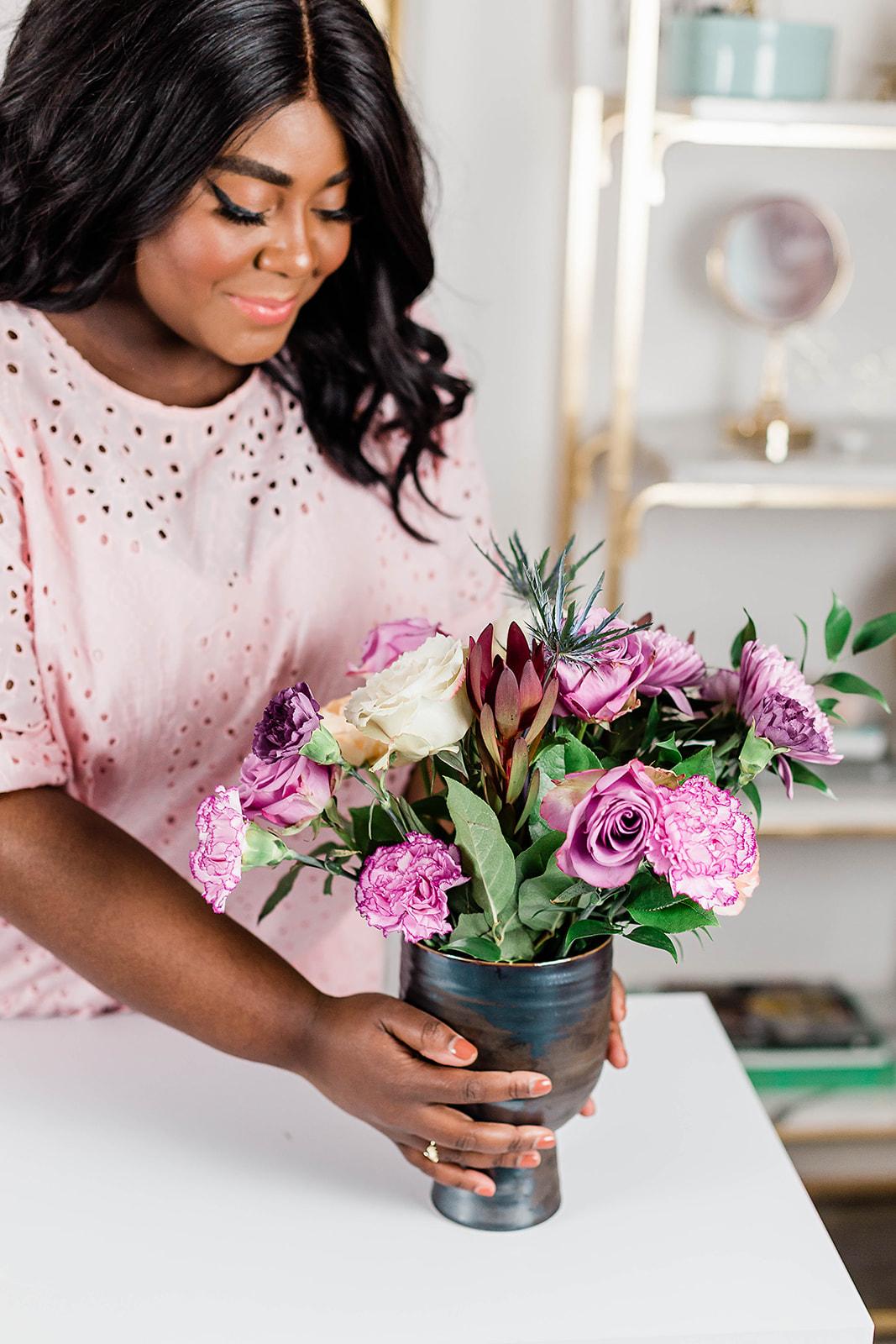 Floral Arranging. Woman doing floral arranging. Floral Arrangement