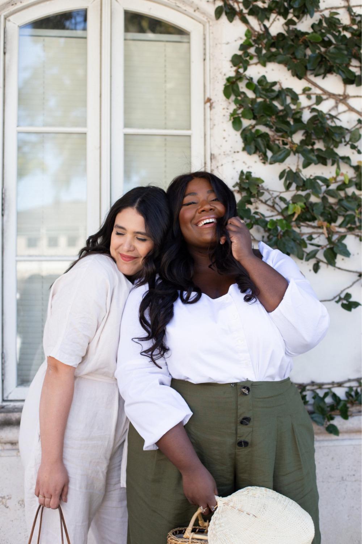 Friends hugging, Black girl smiling